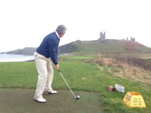 Golf with Dunstanburgh Castle in the background